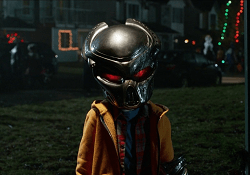 A Human Child with a Predator Mask